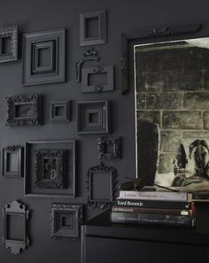 Love the black wall and matching frames.