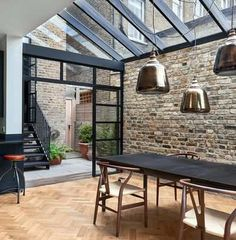 >> The architects chose Crittall-style glazing to encase the single-height space. These black gridded frames also encompass a mono-pitched glass roof. Highbury Hill extension by Blee Halligan Architects. We love the bare brick at reroom uk Home, House Design, Crittal Windows, London House, Property Design, New Homes, Victorian Homes, Victorian Terrace House, House Extensions