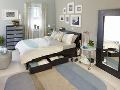 """I love this bed, platform with drawers and look at the """"headboard"""" with the storage behind the slanted and very practical back. The colors are also nice for staging."""