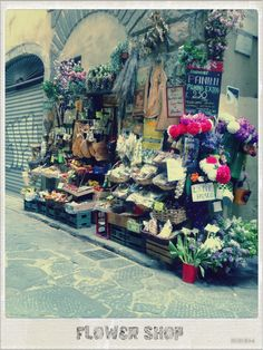 A quaint little flower shop in Florence.Italy. .#By Devika Narain