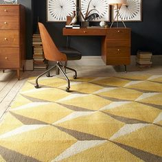 The 100% wool Geo Gemstone Rug is handtufted by Indian artisans and features a graphic, angular pattern that adds depth to floors.