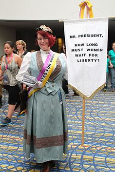 Love this Suffrgettist Costume - have you *seen* what they are doing to our rights lately?  If this is you, let me know and I will send you the full size files. - Also - what is the link you were telling me about? Great costume - she made it!