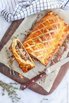 Flaky, Golden and Delicious this Vegan Mushroom Wellington is sure to take center stage at your Christmas or Thanksgiving feast. Learn how to make this vegetable wellington. #vegan #vegetarian #wellington #mushroom #veganchristmas #veganthanksgiving