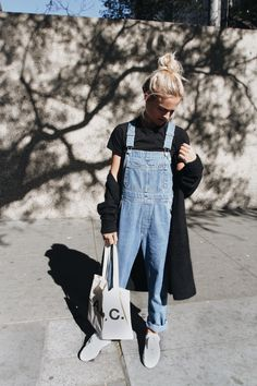 Comme des Garcons heart tee, A.P.C. bag and sneakers, Acne cardigan & vintage dungarees. Via Mija
