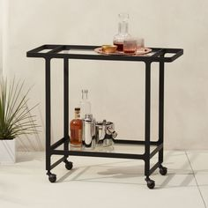 Shop Dolce Vita Outdoor Bar Cart on Wheels. No need to sacrifice looks for location. Designed by Ceci Thompson, sleek double-decker stylishly entertains under the stars.