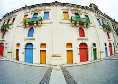 Colourfully resorted storehouses at Valletta Waterfront, Malta.