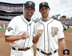 Jeremy Affeldt and Madison Bumgarner showing off their 2012 World Series Rings
