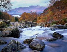 Ashness Bridge near Keswick in the Lake District National Park, Cumbria, England, United Kingdom. Dewent Water and Skiddaw can be seen in the distance. Cumbria, Lake District, United Kingdom, Places To Visit, England, River, Canning, Distance, Bridge