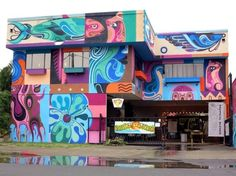 A business in Hawaii covers its premises in brightly colored street art murals with the help of Reka One