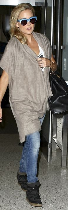 Who made Kate Hudson's black handbag, blue sunglasses, and black boots?