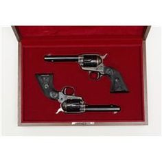 Pair of Colt Peacemaker Single Action revolvers in Colt presentation wood case with plaque on lid