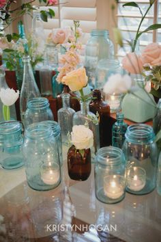 Love Love Love the different old bottles with flowers and candles..maybe we could use some of stevens fav beer bottles..