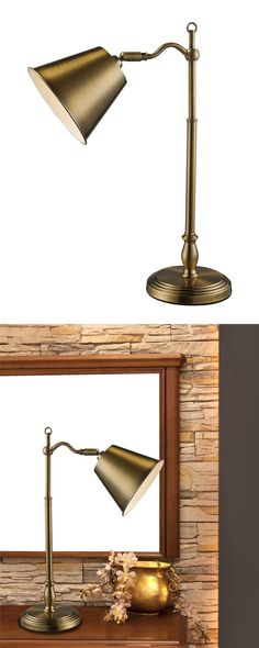 Classic, timeless style suffuses the Jefferson Desk Lamp. We love it on a vintage (or vintage-inspired) desktop. This lamp features antiqued brass finishing over a round base, post-style body, and meta...  Find the Jefferson Desk Lamp, as seen in the The Bohemian Botanist Collection at http://dotandbo.com/collections/the-bohemian-botanist?utm_source=pinterest&utm_medium=organic&db_sku=115380