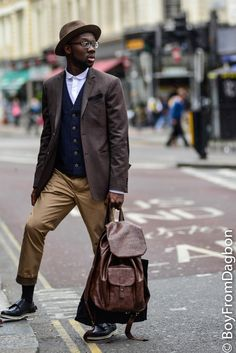 Awesome leather backpack carried by Derek Addo - for men / for him. Chocolate brown leather for city traveling. #travelbags #backpacksformen #streetstyleformen