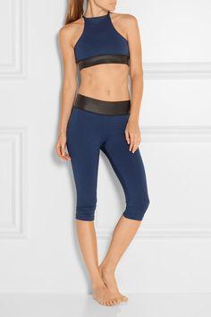 Storm-blue stretch-jersey, black neoprene Slips on 85% micropoly, 15% spandex; trim: 100% neoprene Machine wash