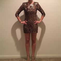 French Connection Copper Sequin Mini Dress French Connection copper colored sequin mini dress. 3/4 sleeves with shoulder pads sewn in. Fit is right through the body with stretch. In excellent condition, never been worn. French Connection Dresses Mini