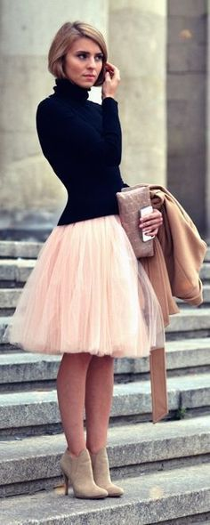 Black ribber turtleneck, pink tulle skirt, tan coat, tan booties.