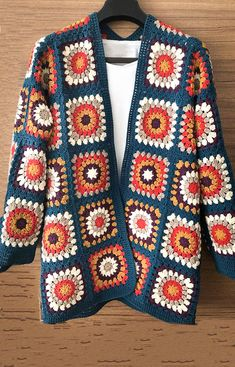 60 Granny Square Crochet Cardigan Pattern Ideas for Summer or Winter Part 53 crochet cardigan crochet cardigan pattern crochet cardigan tutorial crochet cardigan sweater cardigan granny square cardigan granny crochet Gilet Crochet, Crochet Cardigan Pattern, Crochet Jacket, Crochet Granny, Crochet Stitches, Knit Crochet, Funny Crochet, Granny Square Sweater, Granny Square Bag