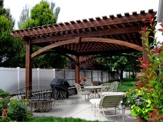 Free standing pergola with Early American stain and Roosevelt profile. Upgraded arched knee braces with keystone. Extended rafters on one side of roof.