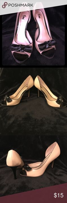 Black and Tan peep toe heels Black and Tan peep toe Fioni heels. Black bow on top. Heel is black. Open on inside portion of shoe. No wear on bottom or sole. FIONI Clothing Shoes Heels