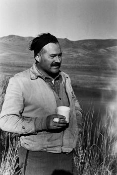 USA. Ernest Hemingway taking a break during a duck hunting trip by Robert Capa, (1940)