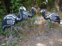 """Easy dollar store flamingo to skellemingo make~over. These are only about 12"""" tall, but added to the 3 larger ones I purchased from Halloween Asylum, the flock is complete for 2013."""