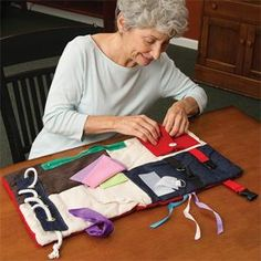Sensory Activity Pad - A multisensory wonder - the proof is in the padding! This pad provides a variety of fun activities and tactile sensations to keep residents with dementia active and busy - lacing, buckling and zipping activities, and a flip-and-feel assortment of fabrics and ribbons.
