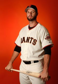 Brandon Belt #9 of the San Francisco Giants poses for a portrait during spring training photo day at Scottsdale Stadium on February 27, 2015 in Scottsdale, Arizona. (February 26, 2015 - Source: Christian Petersen/Getty Images North America)