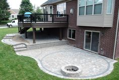 Rochester Hills MI composite deck and brick paver patio. Timber Tech Legacy decking & fascia with Timber Tech Builder rail. Oaks Colonnade brick paver patio.