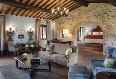 Travel Inspiration for Italy - At Castello di Casole hotel in Tuscany, guests can romp around the green and gold Tuscan countryside, dabble in dough-making at the sweet little pizzeria, dine in elegance at Ristorante Tosca or unwind in the former wine cellar, now a dramatic spa: all barrel-vaulted ceilings, restored stone walls and verdant-valley views