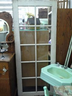 $99 - This vintage solid wood door has 10 glass panes, all in tact. It measures 32 by 77 inches.  It can be seen in booth H 9 at Main Street Antique Mall 7260 East Main St ( E of Power Rd ) Mesa 85207  480 9241122open 7 days 10 till 530 Cash or charge accepted