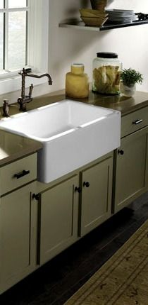 Apron sink...I WILL have one of these in my home someday!