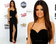 Selena Gomez: Billboard music awards 2011 in Dolce & Gabbana black cut-out dress.