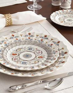 Shaped with graceful scalloped edges, Florence china from Spode was based on an Italian Renaissance manuscript.