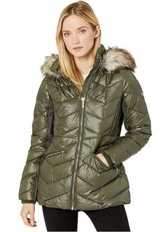 Michael Kors Olive Green Short Down Quilted Puffer Jacket With a Faux-Fur Trim Women's. Women's Quilted Olive Green Puffer Jacket With Faux Fur Trim Hood. Crafted from a quilted poly woven with ribbed internal cuffs at the long sleeves, zipper hand pockets. finish. #PufferCoats #WinterCoats #MichaelKors
