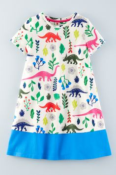 Comfortable and colourful, our pure cotton jersey dress works everywhere – whether you're building a sand castle or a replica Taj Mahal. If that doesn't convince you, just look at our Florasaurus print.