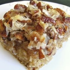 Oatmeal Cake with Coconut Pecan Frosting - moist and delicious cake with loads of toasted coconut pecan frosting.