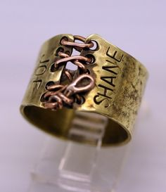 Handstamped Brass and Copper Lace Up Corset Ring is beautiful and edgy. This ring can be customized for you. Limit each of your words to no more than 6 letters. Ring can support multiple lines. MEMBER - Whim Originals