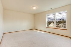 Spacious bedrooms include master suite with deluxe bath in this Beautiful Everett home 45 minutes away from Seattle, WA. Open, easy-flow floor plan presents extensive gleaming flooring, abundant natural light, and inviting wood tones which create comfortable spaces. #EverettWARealEstate #Homes #RealEstate #SeattleRealEstate #TheCastroTeamRE
