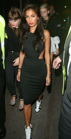 Nicole Scherzinger rocking her Nike Dunk Sky Hi sneaker wedges and a black cut out dress while partying at London's Box Club with Miley Cyrus