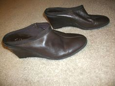 I have a pair of a.n.a. ( A New Approach) Pair of Womens Wedges up for auction. Brown leather, slip on. Size 8 1/2 M. $5.99