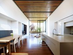 Wooden floor &ceiling (I especially like the black detail) with pale walls: Flemington Residence by Matt Gibson Architecture   Design