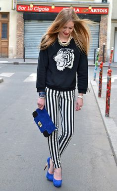 the key to adding a punch to black and white outfits is to add in a single color into your accessories, like this blue here. also, a red lip never hurt anybody.