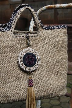Jute fiber hand crochet bag with genuine suede tassel and Japan cotton lining…