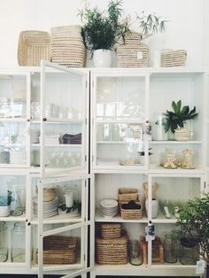 It just feels natural to display your kitchen items in this white glass cabinet. Sorted by category, it doesn't look cluttered.