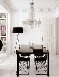 Painted floor, tripod floor lamp, library, dining chairs. Bright white backdrop...LOVE!
