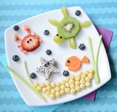 Strawberry crab, kiwi and green grapes turtle, cantaloupe fish, blueberries, Corn Pops ocean bed, star fruit starfish (kiwi fruit ideas)