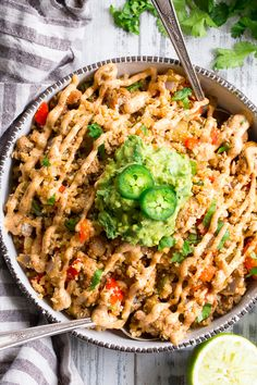 This Mexican Cauliflower Fried Rice is packed with veggies, protein, and lots of flavor and spice! It's topped with an easy guacamole and chipotle ranch sauce for a tasty, filling meal that's Paleo, Whole30 compliant and keto friendly.