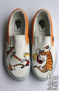 Calvin and Hobbes. <3 FUNNIEST CARTOON EVER!
