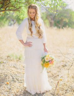 fun alternative to a traditional dress, this bride rocks sleeves + a ruffled skirt